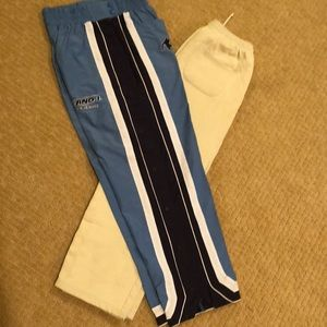A bundle of two pairs of boys basketball pants